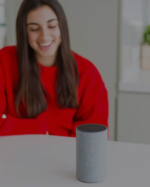 Young Woman in Red with Voice Assistant